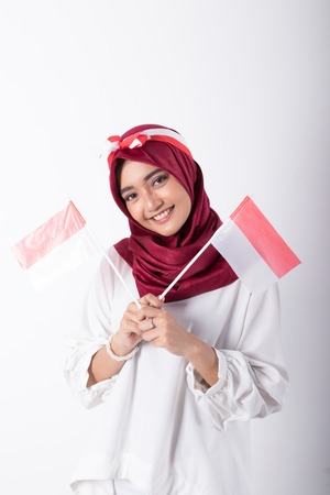 muslim woman with indonesian flag Stock Photo
