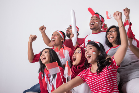 indonesian supporter watching with excitement Banco de Imagens