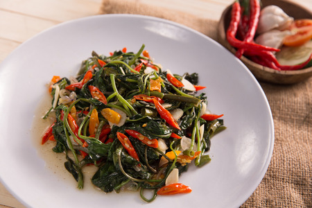 Stir fried water spinach or cah kangkung Stock Photo - 105479128