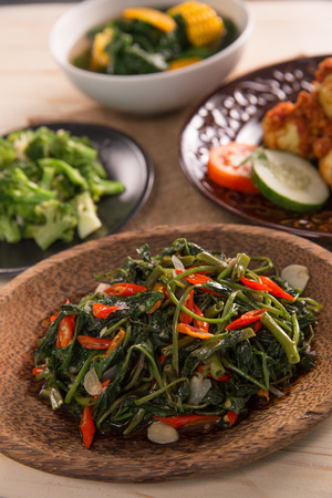 Stir fried water spinach or cah kangkung Stock Photo - 105479498