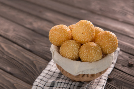 Onde-onde. Indonesian traditional street food on a wooden table background