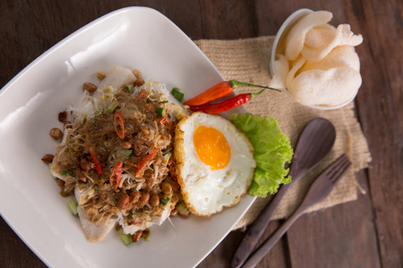 Ketoprak, a vegetarian dish from Jakarta, Indonesia, consists of tofu, vegetables and rice cake, rice vermicelli served in peanut sauce.