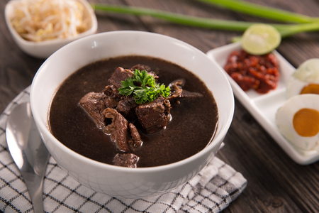 Rawon. traditional Indonesian beef black soup culinary Stock Photo - 105571640