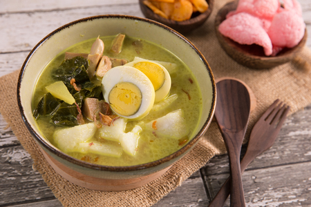 lontong sayur. rice cake with soup Standard-Bild