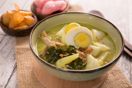 lontong sayur. rice cake with soup Stock Photo