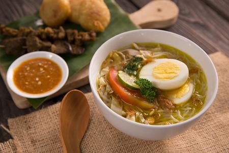 soto ayam. shreedded chicken soup