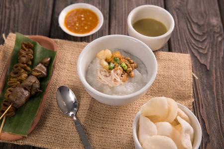 bubur ayam. chicken porridge with soup