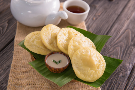serabi. indonesian pancake made of rice flour coconut milk served with sugar syrup Stock Photo
