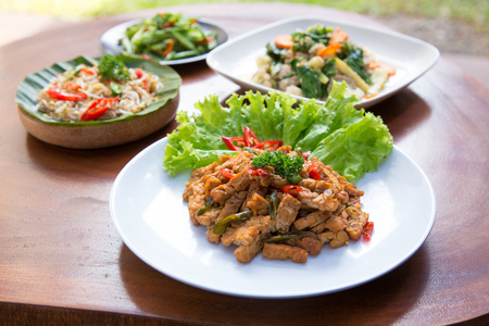 various indonesian food on a table