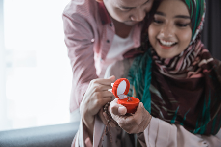 muslim woman suprised get ring 写真素材