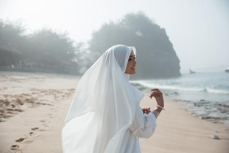 portrait of asian muslim woman in white