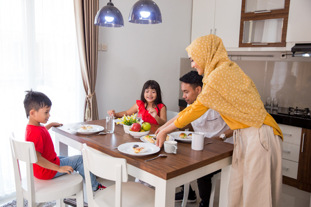 asian muslim family having breakfast