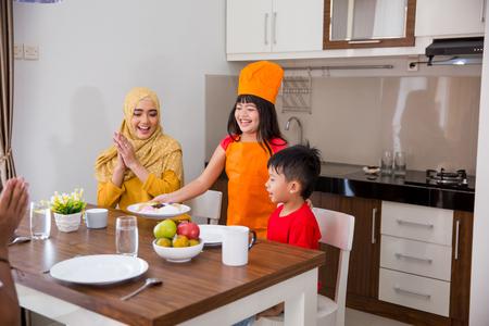 daughter in breakfast preparing Standard-Bild