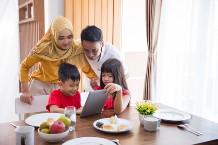 family using tablet pc at home