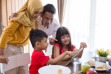 kids and parent using tablet pc