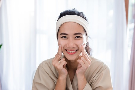 Young woman self face  massage Stock Photo