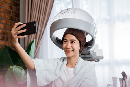 woman taking selfie while getting treatment