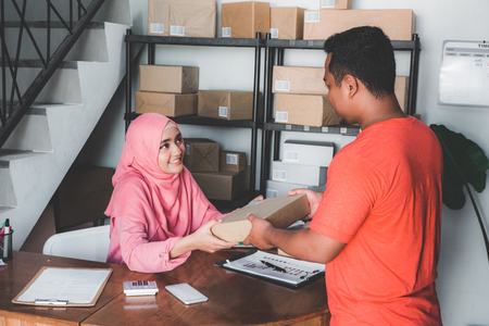 woman given package to costumer