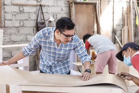 teamwork building a furniture at carpenter workshop