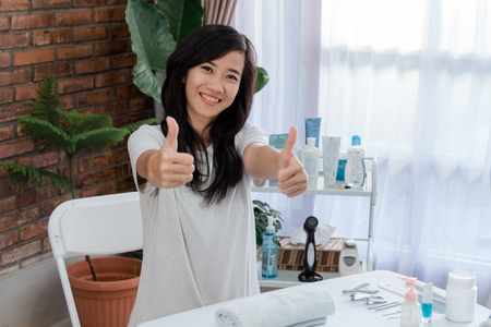 beautiful woman with thumb up Stock Photo