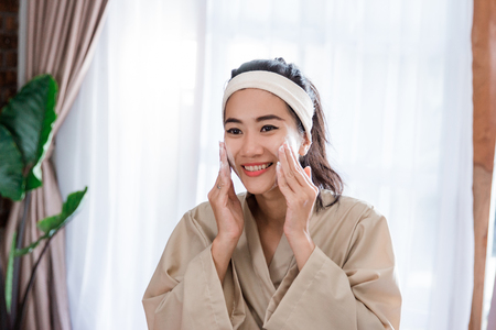 Cheerful woman facial with foam