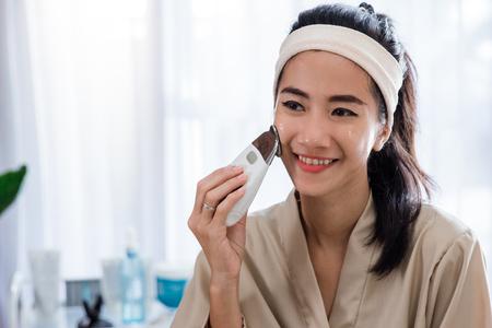 woman doing skin treatment her self