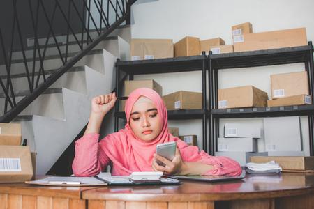 bored young muslim woman working Reklamní fotografie