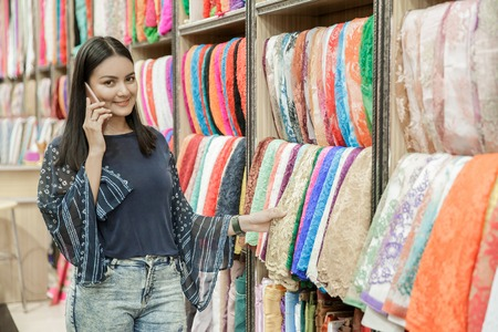 beautiful woman talking on mobile phone while looking around Stock fotó