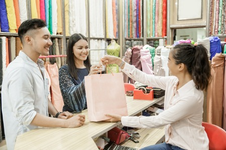 young couple shopping at fabric shop 免版税图像