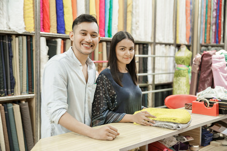 young couple shopping at fabric shop Stock fotó