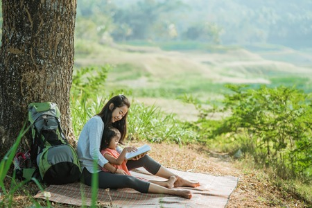 women with a daughter together enjoy of nature Stock Photo