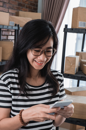 young asian online business owner Stock Photo