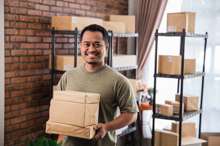 man courier holding package work at shipping package business
