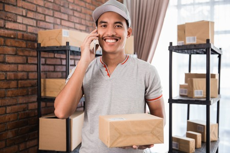 young asian delivery worker at his office