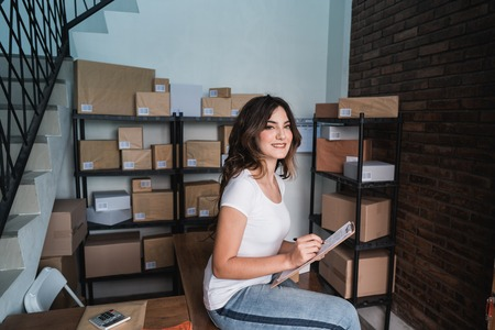 entrepreneur working at home selling product online Stock Photo