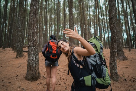 young female hiker waving to friend Stock fotó