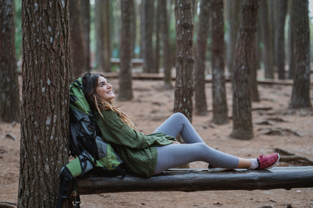 young woman hiker relaxing in the woods Stock fotó