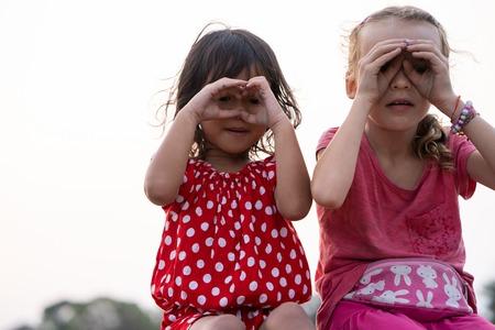 kid showing gesture of looking far