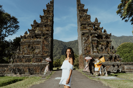 woman taking picture for social media in traditional balinese ga