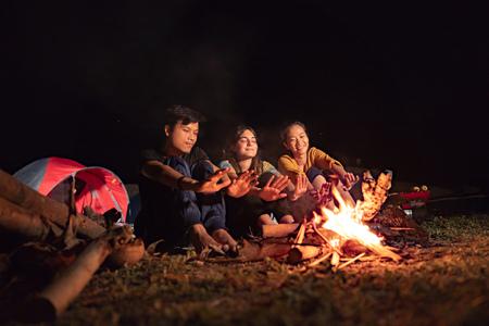A group of friends having fun camping Фото со стока