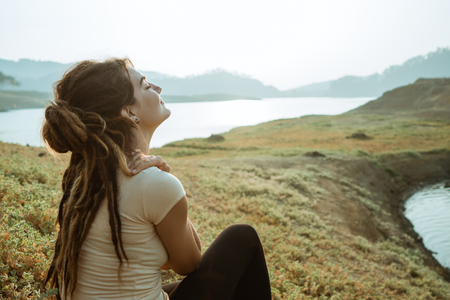 A woman enjoys fresh morning air