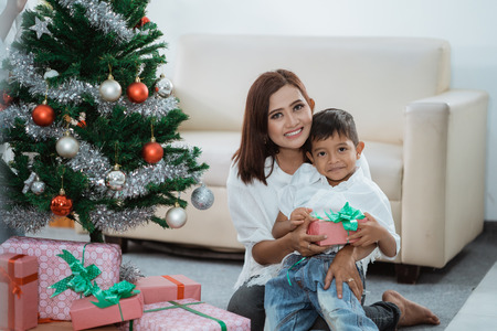 mother and son decorating christmas tree Stock Photo