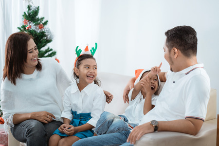 asian family enjoying christmas day together Stock Photo