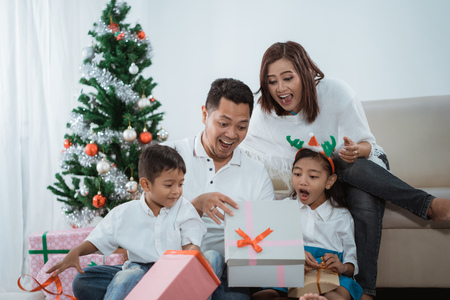 surprise family opening a christmas gif Stock Photo