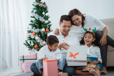 excited family open the gift box together Stock Photo