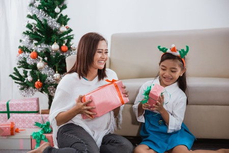 happy daughter laughing after getting present