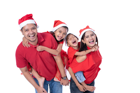 christmas concept asian family piggyback
