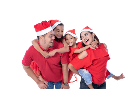 happy asian family wearing red christmas Stockfoto