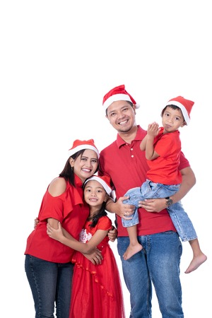 happy asian family wearing red christmas Stock Photo