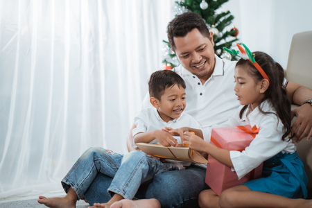 family gift exchange during christmas Stock Photo